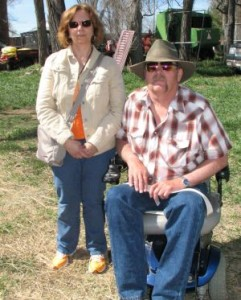 Michael sitting in wheelchair with Rebecca standing next to him