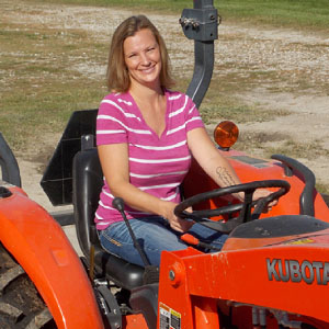 Sara Creech driving tractor