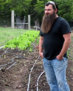 James Jeffers standing in front of urban farm patch