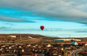 Panorama of Albuquerque, New Mexico, with hot air balloon in sky